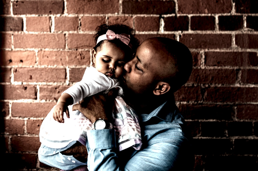 father-gives-baby-daughter-a-kiss